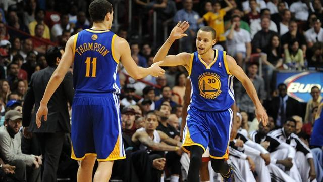 Basketball - Warriors roar back to down Hawks, Lakers end losing streak
