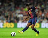 Barcelona's Cameroonian midfielder Alex Song kicks a ball during their Spanish league football match against Granada CF on September 22, at the Camp Nou stadium in Barcelona
