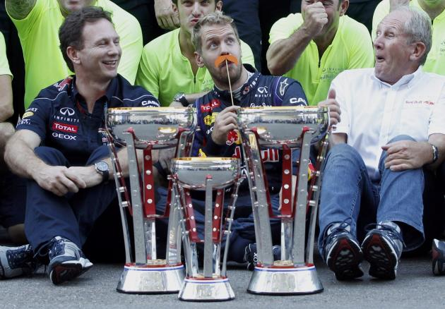 Sebastian Vettel of Germany jokes as he celebrates his win with the Red Bull team after the Austin F1 Grand Prix at the Circuit of the Americas in Austin