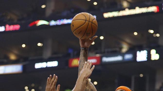 New York Knicks' Kenyon Martin, right, shoots over Los Angeles Clippers' Jared Dudley, left, during the first half of an NBA basketball game in Los Angeles, Wednesday, Nov. 27, 2013