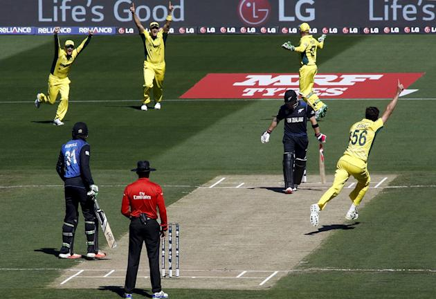 Australia's Mitchell Starc celebrates with teammates after bowling New Zealand's captain Brendon McCullum for a duck during their Cricket World Cup final match at the MCG