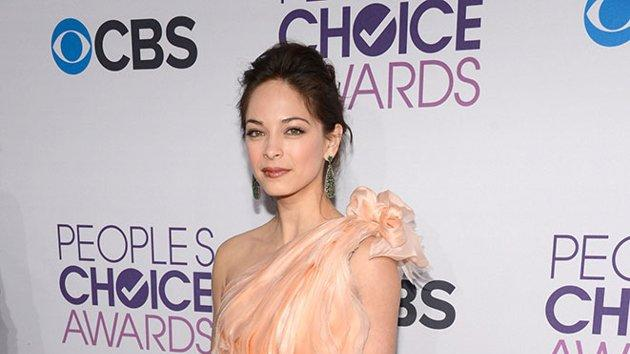 """WORST: Kristin Kreuk.  Did the """"Beauty and the Beast"""" star get lost on the way to a winter formal? Though the peach gown is a lovely color on Kristin, the sequined bottom paired with the frothy top looks a bit junior."""