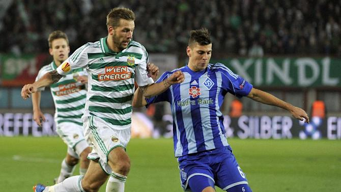 Rapid's Guido Burgstaller, left, and Kiev's Aleksandar Dragovic challenge for the ball, during their Europa League second round group G soccer match between SK Rapid Wien and FC Dynamo Kiev, in Vienna, Austria, Thursday, Oct. 3, 2013