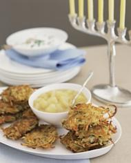 Potato latkes with applesauce -- Getty Images