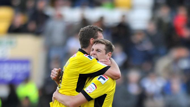 Tranmere's Ben Gibson, left, and Ash Taylor celebrate after the final whistle