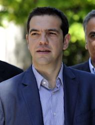 Greece's radical left coalition leader Alexis Tsipras leaves the presidential palace in Athens after talks between party leaders and Greece's president on May 15. Greek political leaders have reacted angrily to a suggestion, attributed to German Chancellor Angela Merkel, that the country hold a referendum on euro membership alongside an election next month