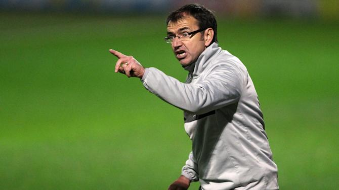 Pat Fenlon hopes that Hearts can overcome their financial difficulties