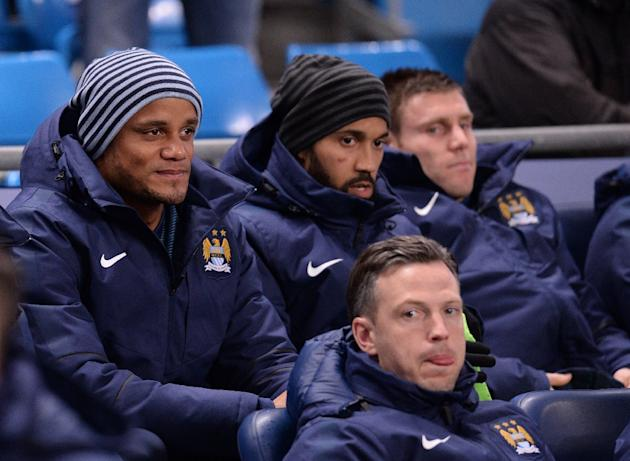 Manchester City's Belgian defender Vincent Kompany (L) looks on from the bench ahead of the English Premier League football match between Manchester City and Leicester City in Manchester, England,