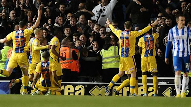 Crystal Palace players celebrate scoring their second goal in front of the away fans (PA Sport)