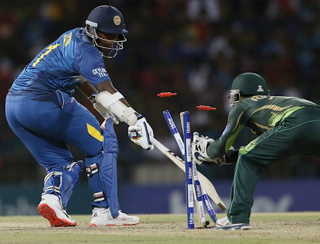 Sri Lanka's Perera is stumped out by Pakistan's wicket Rizwan during their second Twenty20 cricket match in Colombo