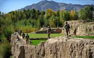 US Army soldiers from Headquarters Company, 173rd Special Troops Battalion attached to 1st Squadron (Airborne), 91st US Cavalry Regiment, 173rd Airborne Brigade Combat Team patrol near Baraki Barak base in Logar Province, on October 11, 2012. NATO may station up to 12,000 troops in Afghanistan to train and assist Kabul's forces after the combat mission there ends in 2014, US officials said