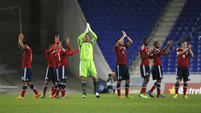 Colombia's goalkeeper David Ospina and team mates acknowledge supporters at the end of the international friendly soccer match against Tunisia in Barcelona