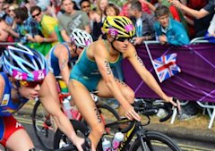 Bronze-medallist Australia's Erin Densham, center, rides past France's Jessica Harrison during the women's triathlon at the 2012 Summer Olympics in Lo