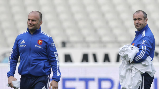 French rugby team head coach Philippe Saint-Andre, right, and his assistant Yannick Bru attend a training session at the stade de France stadium, in Saint Denis, outside Paris, Friday, March 14, 2014. France will play Ireland during a Six Nations Rugby Union match on March 15. (AP Photo/Christophe Ena)