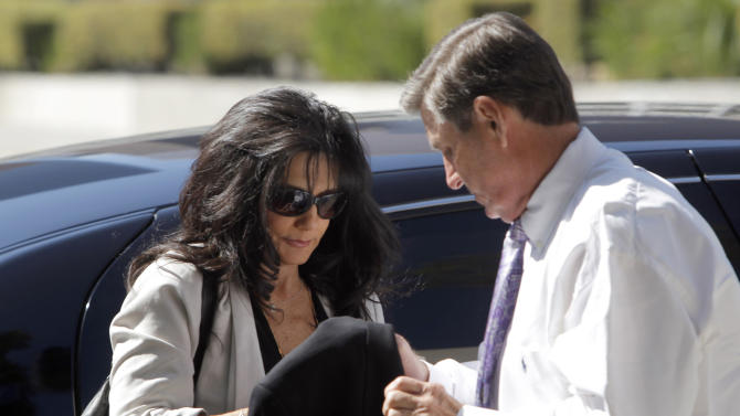 FILE - In this Friday, Oct. 19, 2012 file photo, Britney Spears' parents, Lynne Spears, left, and Jamie Spears arrive at court in Los Angeles. Testimony has opened in a defamation lawsuit against Britney Spears' parents, with a top record executive, Barry Weiss, saying on Monday, Oct. 22, 2012, he was never told that plaintiff Sam Lutfi was her manager. (AP Photo/Nick Ut, File)
