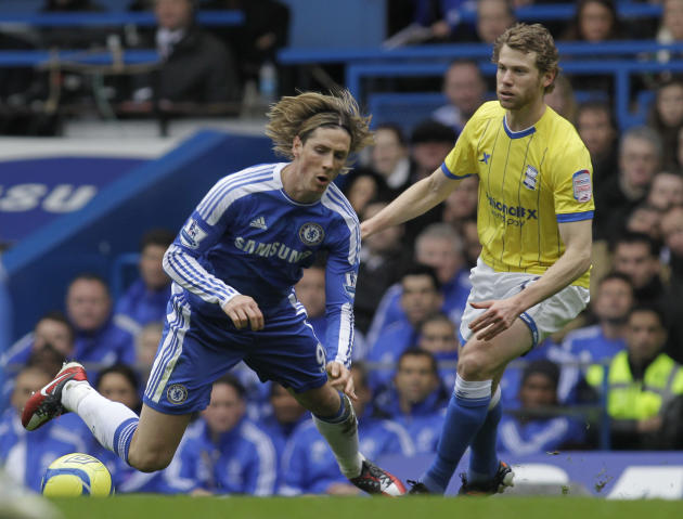 Chelsea's Fernando Torres, left, is tackled by Birmingham City's Jonathan Spector during their English FA Cup fifth round soccer match at Stamford Bridge, London, Saturday, Feb. 18, 2012. (AP Photo/Sa