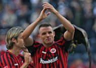 Frankfurt's midfielder Alexander Meier celebrates after the German first division Bundesliga football match Eintracht Frankfurt vs SC Freiburg the western German city of Moenchengladbach. Frankfurt won the match 2-1