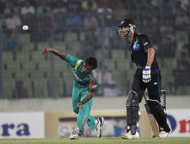 Bangladesh's Rubel Hossain bowls as New Zealand's Grant Elliott watches during their second ODI cricket match in Dhaka