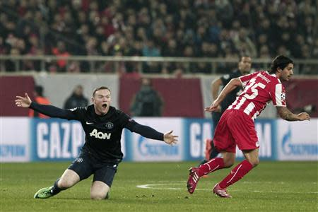 Manchester United's Rooney reacts during their Champions League round of 16 first leg soccer match against Olympiakos in Piraeus