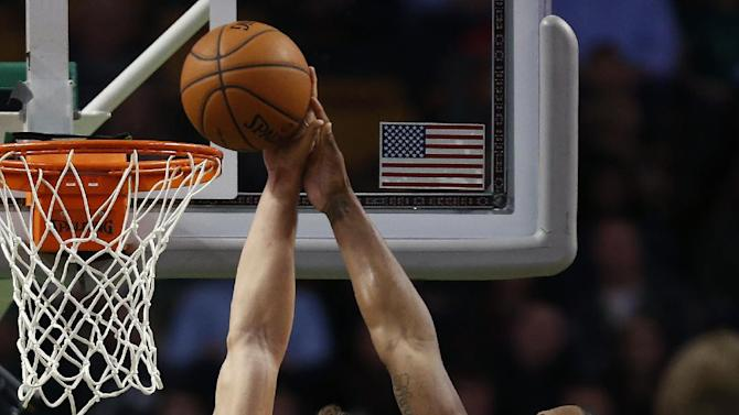 Denver Nuggets' Darrell Arthur (00) blocks a shot by Boston Celtics' Kris Humphries (43) in the second quarter of an NBA basketball game in Boston, Friday, Dec. 6, 2013