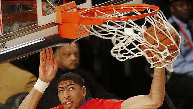 West Team's Anthony Davis, of the New Orleans Pelicans (23) dunks the ball against the West Team during the NBA All Star basketball game, Sunday, Feb. 16, 2014, in New Orleans