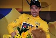 Switzerland's Fabian Cancellara celebrates after winning the 6.4 km individual time-trial and prologue in Liege. Cancellara of Switzerland won the race-opening prologue of the Tour de France here Saturday to claim the first race leader's yellow jersey of the 99th edition