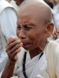 A Cambodian nun sobs as she mourns the death of former monarch Norodom Sihanouk during a rally outside the Royal Palace in Phnom Penh