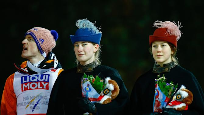 Freund of Germany prepares for the flower ceremony of the men's large hill individual ski jumping event at the Nordic World Ski Championships in Falun