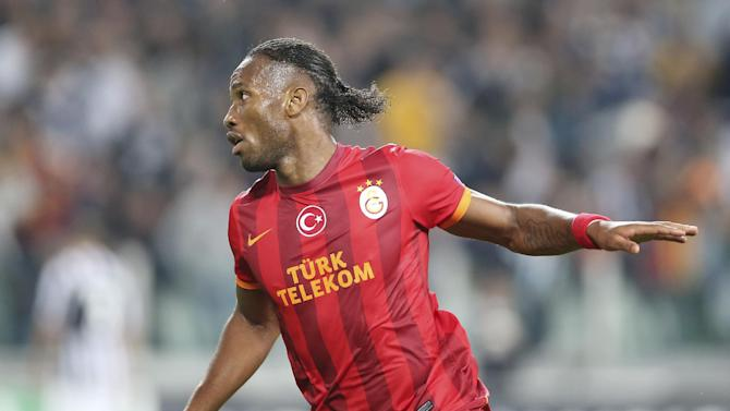 Galatasaray forward Didier Drogba, of Ivory Coast, celebrates after scoring during a Champions League, Group B, soccer match between Juventus and Galatasaray at the Juventus stadium in Turin, Italy, Wednesday, Oct. 2, 2013
