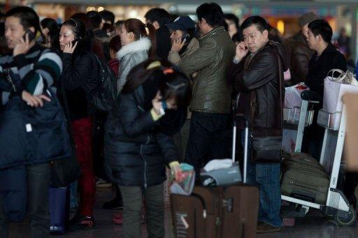 Lunar New Year travellers queue at Beijing's international airport on February 6, 2013