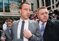 "Chelsea and England footballer John Terry leaves Westminster Magistrates' Court in London. Terry was cleared on Friday of allegations that he racially abused rival footballer Anton Ferdinand, the judge saying it was the ""only verdict"" he could reach"