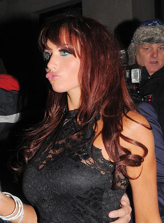 Amy Childs stepped out in support of her cousin and former TOWIE co-star, Harry Derbidge's jewllery line launch. Whilst her dress looked amazing, her lips looked suspiciously plumped up.