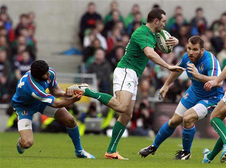 Ireland's Kearney is challenged by Italy's Esposito in their Six Nations rugby union match at Aviva stadium in Dublin