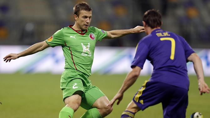 Rubin Kazan's Oleg Kuzmin, left, is challenged by Maribor's Ales Mejac, during their group D Europa League soccer match, in Maribor, Slovenia, Thursday, Sept. 19, 2013