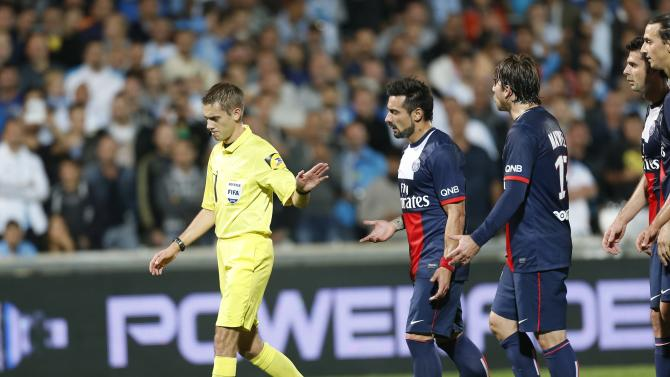 Paris Saint Germain's Lavezzi talks to referee Turpin during their French Ligue 1 soccer match against Olympique Marseille in Marseille