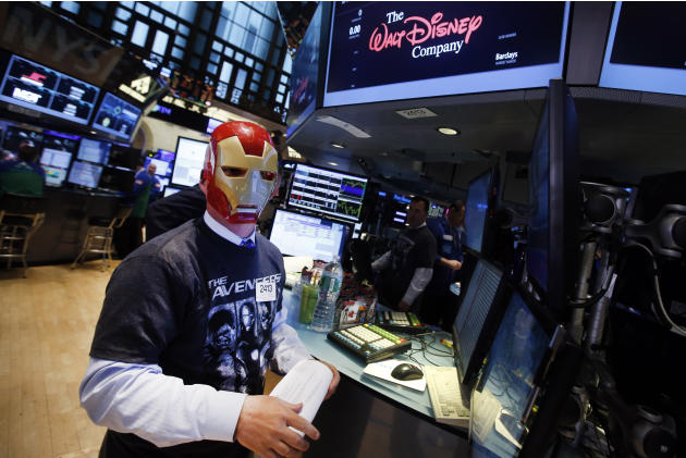 Trader John O'Hara wears an Ironman mask as he works on the floor of the New York Stock Exchange, Monday, April 27, 2015, in New York. Actors Jeremy Renner and Robert Downey Jr. rang the NYSE open