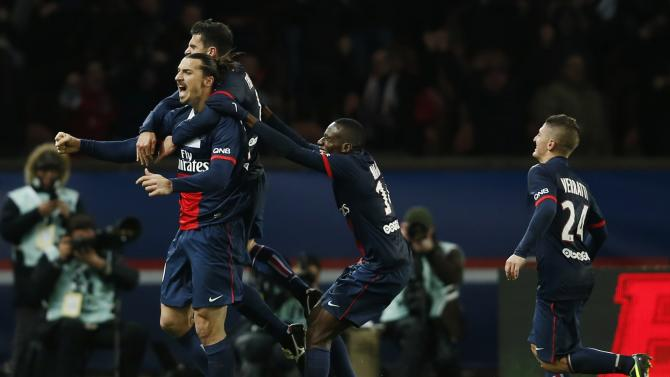 Paris St Germain's Ibrahimovic celebrates with teammates after scoring against Lille during their French Ligue 1 soccer match in Paris