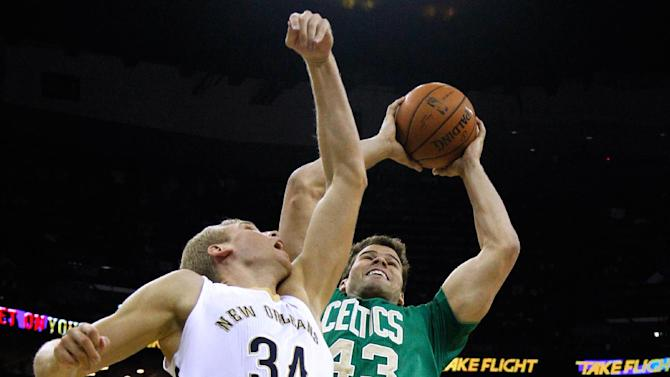 Boston Celtics center Kris Humphries (43) and New Orleans Pelicans center Greg Stiemsma (34) go for a rebound during the first half of an NBA basketball game in New Orleans, Sunday, March 16, 2014