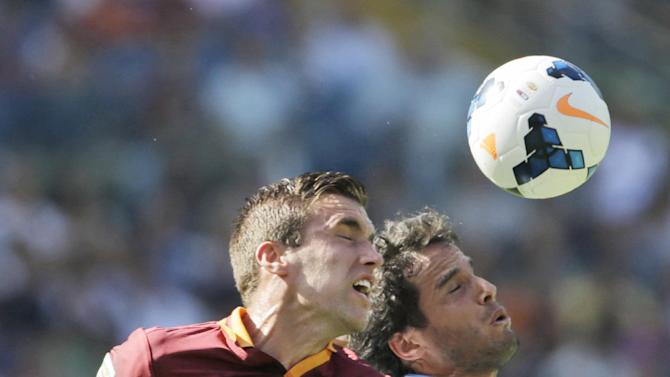 AS Roma midfielder Kevin Strootman of The Netherlands, left, and Lazio midfielder Alvaro Gonzalez of Uruguay jump for the ball during a Serie A soccer match between As Roma and Lazio, in Rome's Olympic stadium, Sunday, Sept. 22, 2013