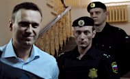 Russian protest leader Alexei Navalny arrives in court in the provincial city of Kirov on April 17, 2013. He goes back on trial on Wednesday on embezzlement charges that he claims were ordered by President Vladimir Putin to foil a dangerous political rival