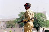 A Pakistani soldier stands guard outside the French embassy in Islamabad, in 2002. Several Western embassies in Islamabad received letters on Wednesday containing suspicious powder and threats to poison supplies for NATO soldiers in Afghanistan, officials said