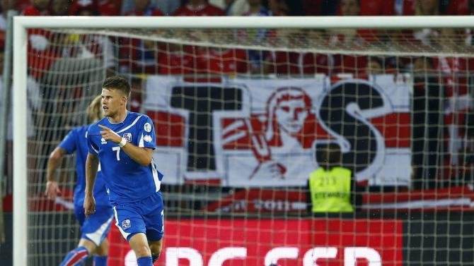 Iceland's Gudmundsson celebrates after scoring a goal during their 2014 World Cup qualifying soccer match against Switzerland in Bern