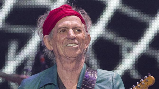 Keith Richards of The Rolling Stones performs at the O2 arena in east London, Sunday, Nov. 25, 2012. The band are playing four gigs to celebrate their 50th anniversary, including two shows at London's O2 and two more in New York. (Photo by Joel Ryan/Invision/AP)