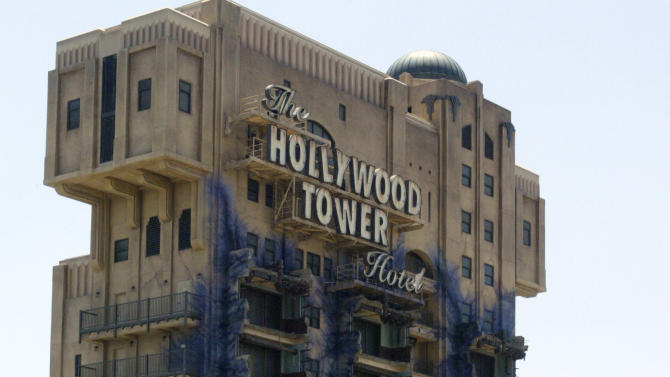 """FILE - In this May 4, 2004, file photo, The Twilight Zone Tower of Terror ride at the Disneyland Resort is seen in Anaheim, Calif. Some fans are outraged at the decision to close the ride and revamp it into a """"Guardians of the Galaxy"""" themed attraction. The plan was greeted with boos when it was announced at the San Diego Comic Con in July 2016. (AP Photo/Damian Dovarganes, File)"""