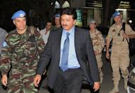 Moroccan advance team leader Colonel Ahmed Himmiche (L) and Niraj Singh (C), spokesman to the UN monitors team, tasked with monitoring the UN-backed ceasefire in Syria, arrive in Sheraton hotel in Damascus, on April 23, after visiting several rebellious suburbs near the capital. Nearly 60 people were reported killed in violence across Syria on Monday