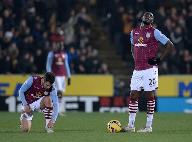 Aston Villa's Joe Cole (L) and Christian Benteke react during their English Premier League match against Hull City, at the KC Stadium in Hull, north-east England, on February 10, 2015