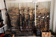 A picture taken on April 4, 2013 shows weapons given by the Chadian government to fight poachers and tusks seized in Chad's Zakouma National Park. In an isolated wilderness in Chad, a war is being fought to save central Africa's decimated elephant herds from gangs of ivory poachers