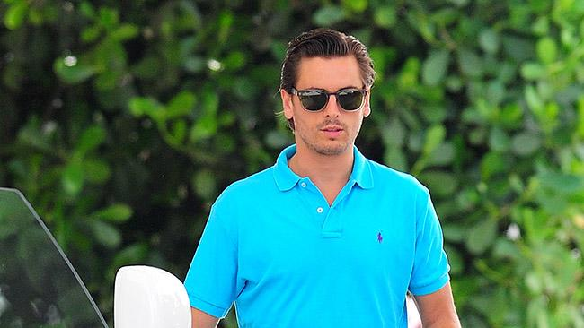 Scott Disick leaving his Miami Hotel in his new Rolls Royce, Florida