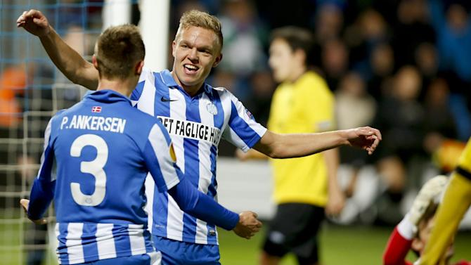 Esbjerg fB's Mick van Buren  celebrates scoring a goal with teammate Peter Ankersen during their Europa League group C soccer match in Esbjerg, Denmark, Thursday, Nov. 7, 2013