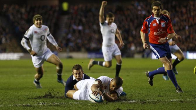 England's Luther Burrell scores a try against Scotland during their Six Nations rugby union match at Murrayfield Stadium in Edinburgh